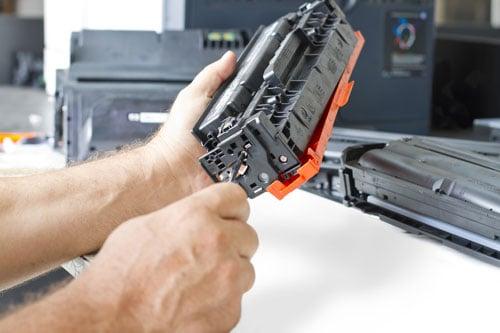 Technician Fixing Printer